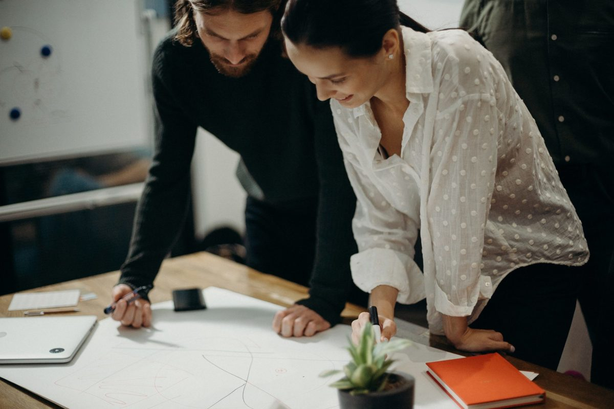 A team creating designing on a table in an office